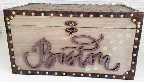 Dog memorial box with calligraphed and laser cut name sign, painted and mounted.