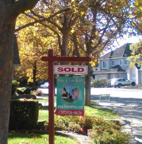 Yard with Real Estate Sign with Sold Rider