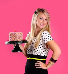 Alyssa shows off a pretty pink cake with sprinkles