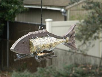 DIY Nautical Decor Fish shaped bottle bird feeder. www.DIYeasycrafts.com