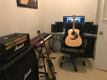 acoustic guitar on office chair in recording studio suite for rent in nyc