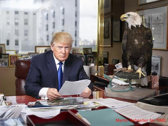 Donald Trump Painting Eagle on desk photo