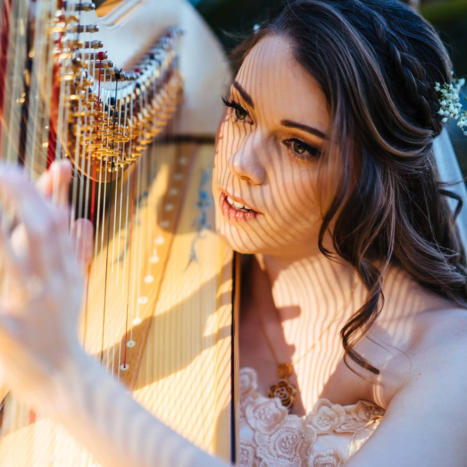 A musical bride enjoys playing Bart's harp following her ceremony