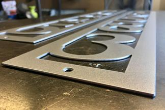 Surface-tek provides custom metal fabrication for Apartment signs