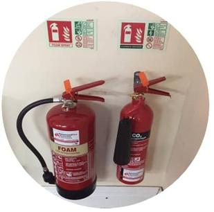 Wall mounted Fire Extinguishers and signage