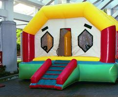 Colorful Moon Bounce for Entertainment at Company Picnics, Birthday Parties, and Festivals.