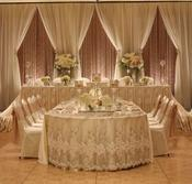 Backdrops for weddings head table decor for weddings draping lighting crystals flowers lace satin chiffon panels layered backdrops chandeliers glass balls