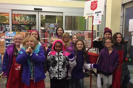 girl scouts ringing salvation army bell
