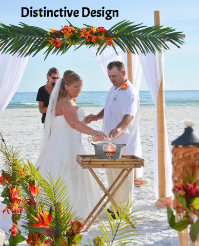 A bride and groom perform the Unity Sand Ceremony, which is included in all of our St. Augustine Beach Wedding Packages.