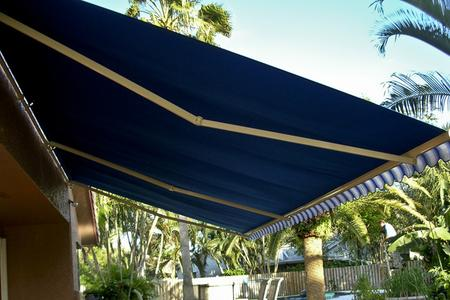 retractable fabric awning over deck