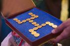 swastik_gold_coin_indian wedding _photo