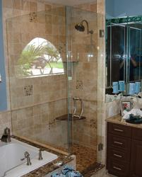 Frameless corner shower with kneewall panel