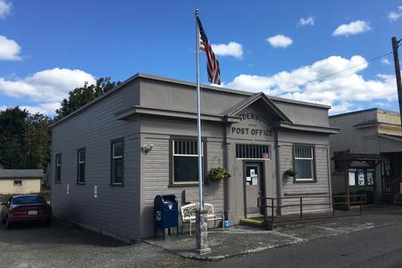 Ryderwood post office exterior with raised flag.