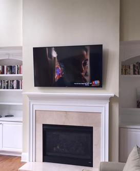 flat screen 4k ultra hd tv hung over fireplace in charlotte nc