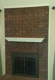 picture of brick fireplace before Carolina Custom Mounts installed flat screen tv and components, charlotte tv installers