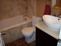 This bathroom renovation was a complete gut down to studs. A custom jet tub was installed with tiled skirt and tub surround. An intricate shower system was installed including 2 isolated shower heads and telephone shower. New ceiling exhaust was installed, along with new flooring, cabinets, paint, fixtures, and accessories.
