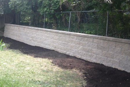Decorative block retaining wall was laid at Ann Arbor residence.