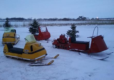 SNOWMOBILES WE RIDE AND COLLECT WAITING FOR A SPOT IN THE MUSEUM