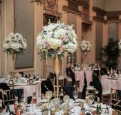 view of reception rooms linens centre pieces backdrops dance floors ceiling decor chandeliers lighting chair covers sashes flowers