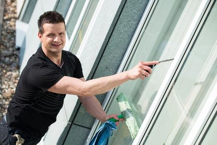 commercial window cleaning with mop and squeegee