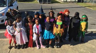 A group of students posing in their halloween costumes