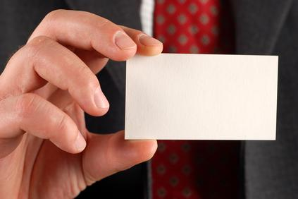 A business man holding a blank business card
