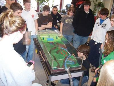 Students using a Ward's Flood Model as part of the Flood Risk in Schools Program.