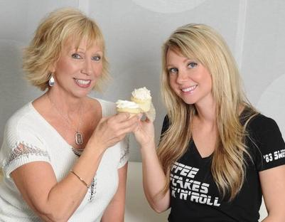 Julie and Alyssa share a cupcake toast