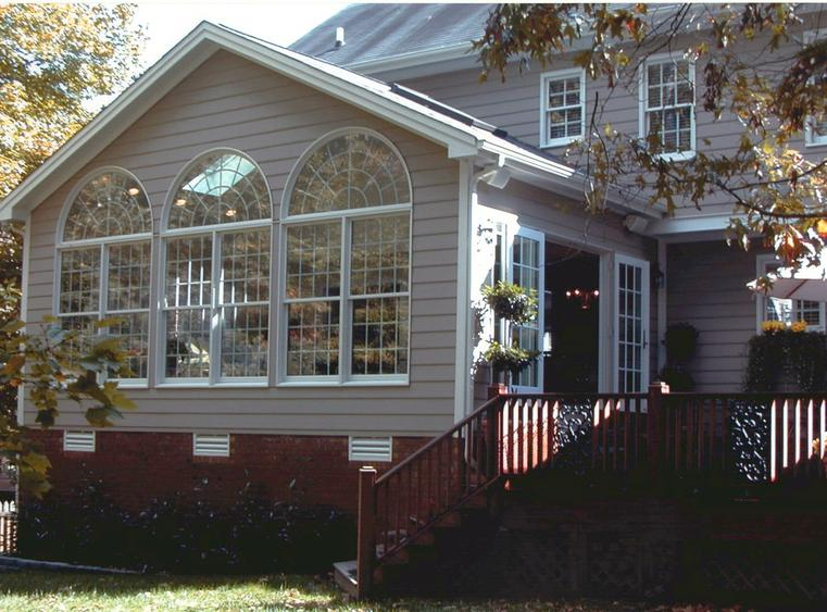 Sunroom with circle topped windows