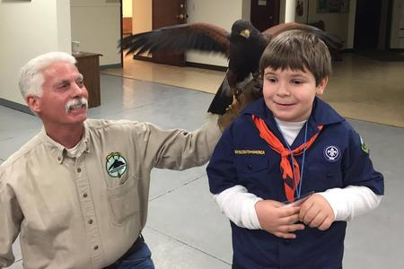 boy scout with bird