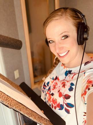Haley, a female voice actor, in a recording session for a happy client!