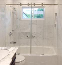 Frameless tub enclsure