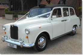 Classic London Taxi Wedding Car in Ivory and Black - Essex Wedding Cars