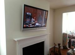 Carolina Custom Mounts, Flat Screen TV mounted over fireplace, Charlottes best tv mounting services