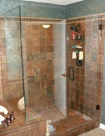 Frameless shower door and panel with kneewall