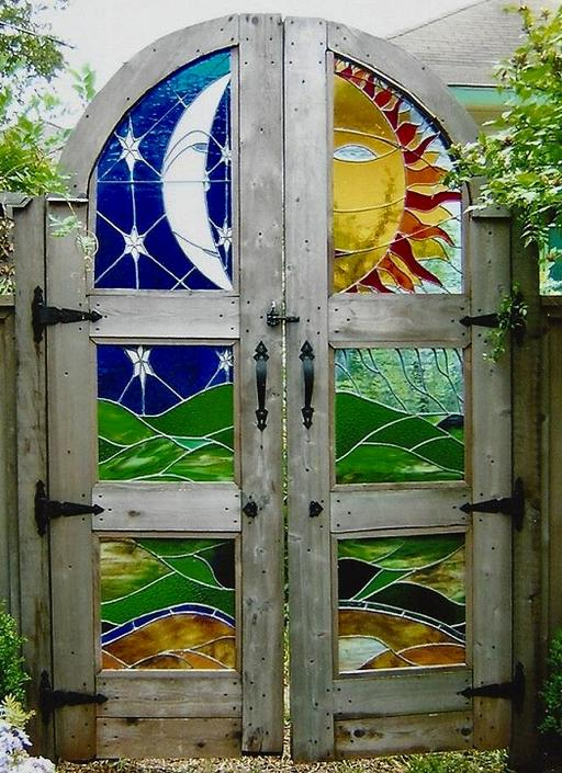 El Sol Y La Luna Stained Glass Garden Gate installed at historic Austin home