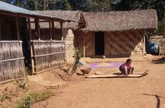 A tribal women busy with household chores at Shikdamakha