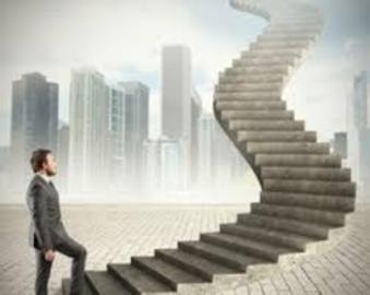 Graphic image of a business man in a gray business suit taking the 1st step forward onto a tall concrete corporate stairway that is shown leading up and forward to the sky. Backdrop shows tall city skyscraper scene.