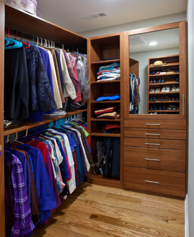 Beautiful lypus cabinets in custom closet system in Owner's bedroom closet