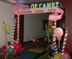 Land of Candy Theme Prom Decor - Rainbow Colored Road at entrance with striped candies.