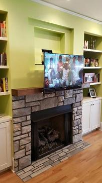 TV mounting service installation of flat screen tv that pulls down and out from over fireplace, Charlotte NC,
