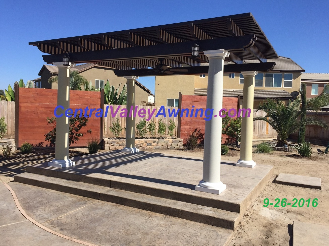 A 52' patio cover and the beam is perfectly straight. Look at the lights.  You can see the light's mounting plate on all the posts. - Home_CVA.html