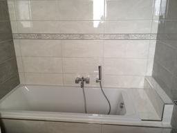 newly tiled bath tub surround