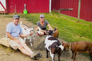 George and Cinda Malouin with Nigerian Dwarf goats at my peeps farm.