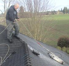 Man doing roof shampooing on home in Eugene, OR