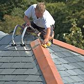 Man providing services by our roofing companies in Holland, PA