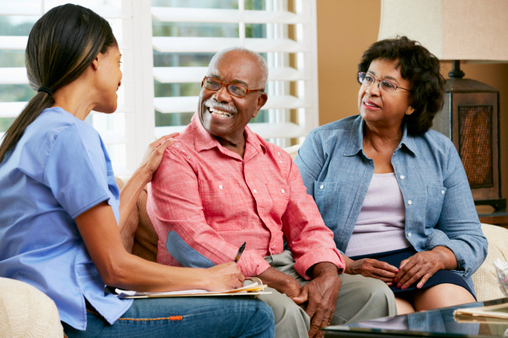 A family talking to a staff member at Everlasting Family Home Care Services.