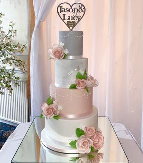 Pretty grey blush and marble 4 tier sugar rose wedding cake