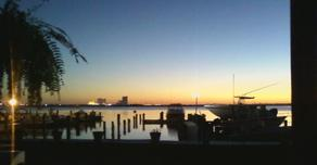 Sunset over dock and Atlantic City skyline