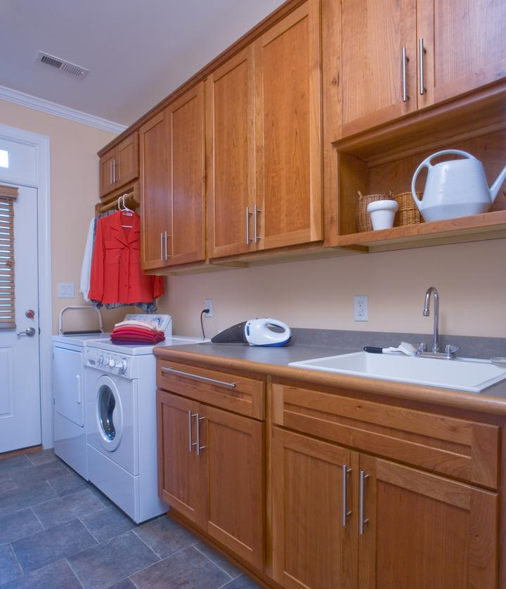 Laundry room with plenty of cabinet storage and a place for hanging clothes